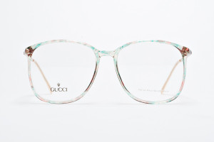 Oversized vintage Gucci glasses with watercolor pattern.