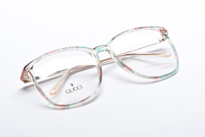 Pastel colored vintage Gucci eyeglasses with watercolor pattern.