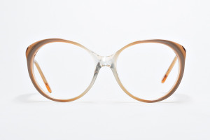 70's  or 80's Fashion, muted glasses in browns and creams .