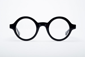 Round, big black glasses. Unbranded and bold. Handmade in the USA,