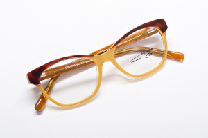 Contrasted yellow and brown color block cat eye glasses. Petite to average fit. Elvira measures 49-15-135 (B 35)