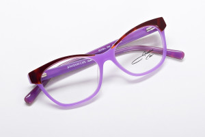 Color black glasses in high contrast of lavender and brown tortoise. Elvira is a cat eye that fits petite to average faces.