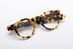 Round glasses for a wide face. Folded view of Gunpowder, P3 round glasses by Jonathan Cate in Tokyo tortoise.