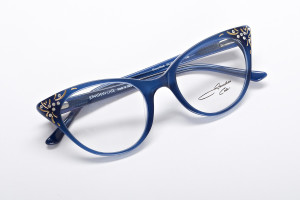 Modern blue cat eye glasses with jeweled tips.