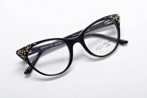 Glossy black embellished cat eye glasses. Updated take on midcentury style.