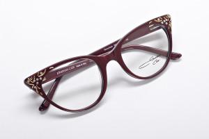 Maroon glasses with modern cat eye shape and mild embellishments / jeweles to shine.