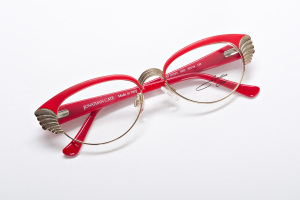 Red hot retro inspired cat eye glasses with wing details. Rockabilly fashion.