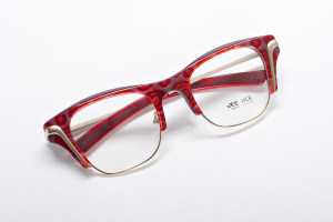 Retro inspired glasses in vivid red swirl color and squared shape.