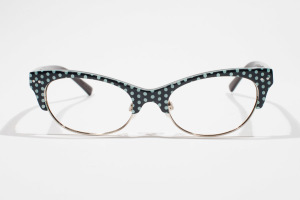 Cat eye shaped glasses with polka dot pattern in black and sea foam.