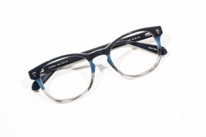 Folded view of striped color block glasses in blue and crystal gray.