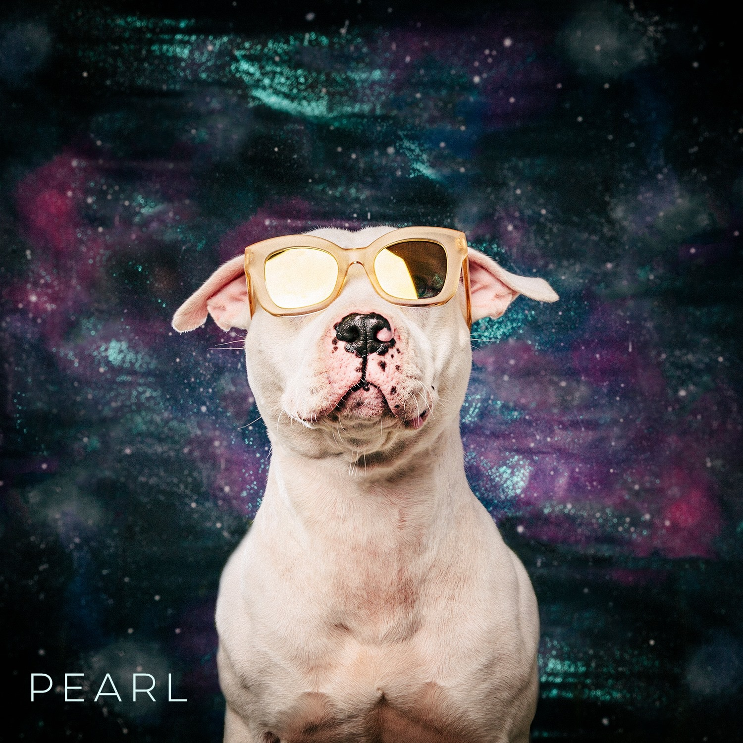 Pearl wearing KREWE sunglasses with yellow mirror lenses